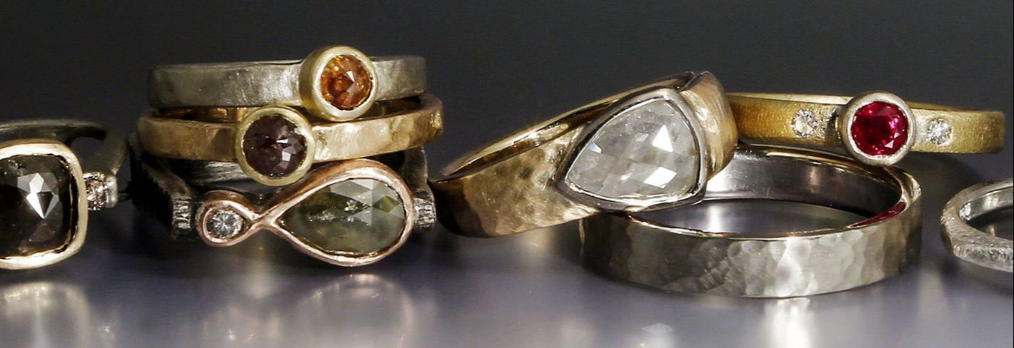Wedding & engagement rings set with rustic, rosecut diamonds with softly textured golds