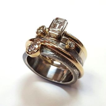 Restyling of several family gems and rings combined into one glorious, contemporary and meaningful piece